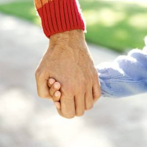 Adult and Daughter (9-10) Holding Hands